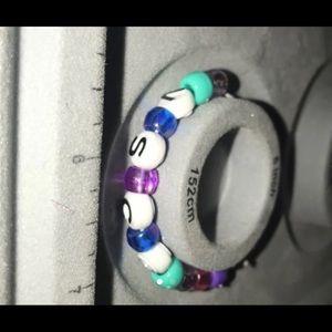 a bracelet that says vsco
